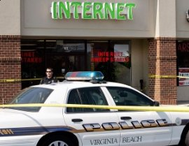 Police raided about a dozen sweepstakes cafes throughout Virginia Beach, including this one at Timberlake Shopping Center on Holland Road on Wednesday, Sept. 22, 2010. They seized 400 to 500 computers used in suspected illegal gambling. <span class='credit'>(David B. Hollingsworth | The Virginian-Pilot)</span>
