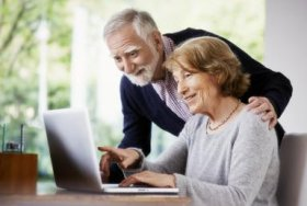 Senior couple at home using a laptop - Oliver Rossi/The Image Bank/Getty Images